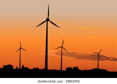 Four wind turbines against dramatic sunset producing environment friendly energy