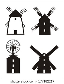 Four windmill silhouettes