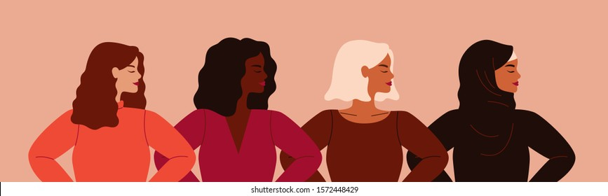 Four women of different nationalities and cultures standing together. Women's friendship, union of feminists or sisterhood. The concept of the female's empowerment movement.