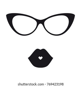 frame of glasses in the style of cat eyes and black silhouette of lips in a kiss