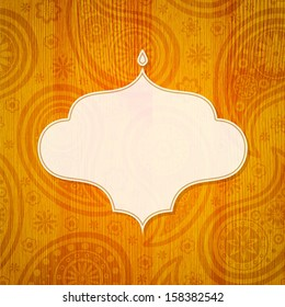 Frame in the Indian style on the wooden background with paisley pattern. Vector illustration.