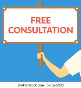FREE CONSULTATION. Hand holding wooden sign