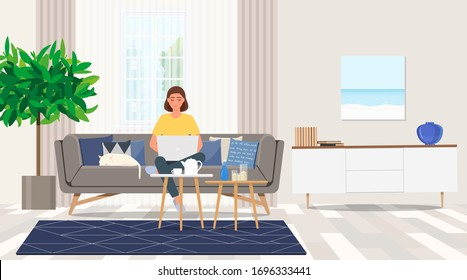 Freelance girl with laptop sitting on the couch.