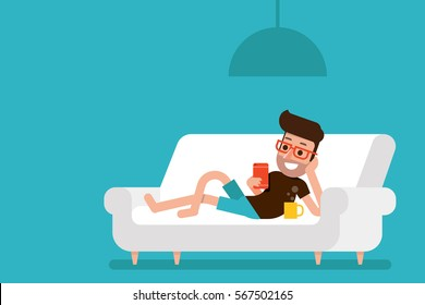 Freelancer working at home with smartphone on cozy sofa.