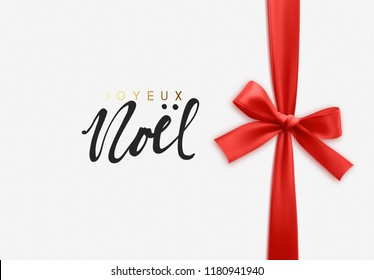 French lettering Joyeux Noel. Merry Christmas Holiday background. Handwritten text, realistic textured pattern, pull ribbon bow.