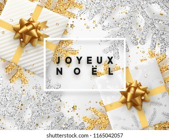 French lettering Joyeux Noel(Translation Happy New Year and Merry Christmas) . Christmas background with gifts box and shining golden and silver snowflakes. Xmas Greeting card. Vector Illustration.