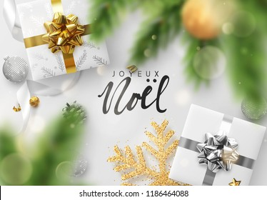 French text Joyeux Noel. Christmas composition realistic decoration objects, gift box presents, confetti, snowflake and Xmas balls. Spruce branches pine cone. Bright festive design, greeting card.