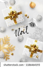 French text Joyeux Noel. Christmas vector background. Creative design greeting card, banner, poster. Top view gift box, xmas decoration balls and snowflakes.