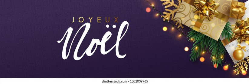 French text Joyeux Noel. Christmas banner, Xmas festive decoration. Horizontal christmas posters, cards, headers, website. Sparkling lights garland with gifts box and green pine branches.