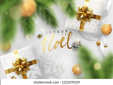French text Joyeux Noel. Merry Christmas and Happy New Year. Background design decoration gift box, pine branches, gold balls, decorative snowflake in glitter. Xmas bauble, silk ribbon.