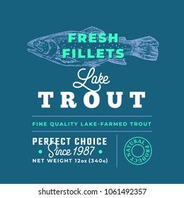 Fresh Fillets Premium Quality Label . Abstract Vector Fish Packaging Design Layout. Retro Typography with Borders and Hand Drawn Lake Trout Silhouette Background.