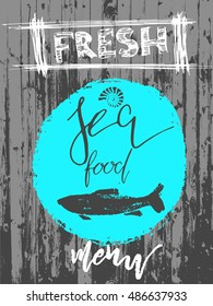 fresh fish seafood on wooden background with artistic lettering