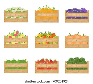 Fresh healthy vegetables and fruits in a wooden boxes.