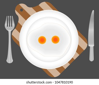 fried eggs on a plate. The fork, knife and kitchen wooden board