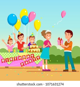 Friend guest boy giving present to girl celebrating birthday. Teen kids birthday party festivity with hats, balloons & confetti. Girl receiving gift. Flat style isolated vector character illustration