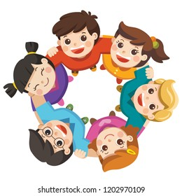 Friendship boys and girls standing arm in arm forming a circle looking up at the viewer. Happy group children isolated.