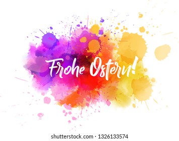 Frohe Ostern - Happy Easter in German. Abstract watercolor imitation splash background with calligraphy text. Easter concept background.