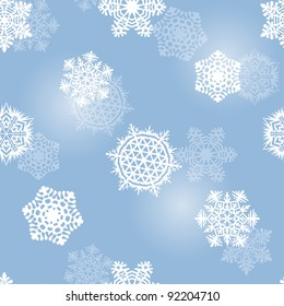Frosty blue seamless background with pretty snowflakes (eps10)