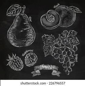 Fruit drawn in chalk on a blackboard set, pear, peach, raspberry, grape