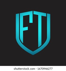 FT Logo monogram with emblem shield design isolated with blue colors on black background