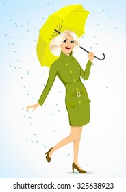 full body portrait of friendly blonde woman in a green autumn coat holding an umbrella and standing under the rain