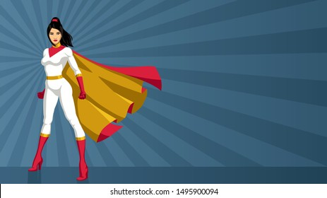 Full length illustration of determined and powerful Asian superheroine wearing red and yellow cape while standing tall against abstract ray light background.