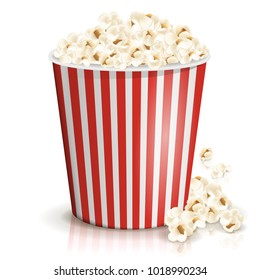 A full red-and-white striped bucket of fluffy popcorn isolated on the white background. Vector illustration. Popcorn fallen from cardboard or paper bucket. Cinema snack and movie food.