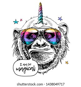 Fun Monkey in a rainbow glasses, with a unicorn horn and with a stars. I am so magical - lettering quote. Humor card, t-shirt composition, hand drawn style print. Vector illustration.