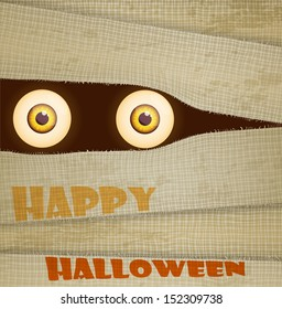 Funny Halloween greeting card (invitation) with big eyes of mummy.