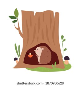Funny Hedgehog as Forest Animal Reserving Mushrooms in Tree Hollow Vector Illustration