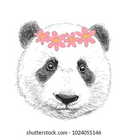 Funny panda in a flower wreath. Vector illustration.