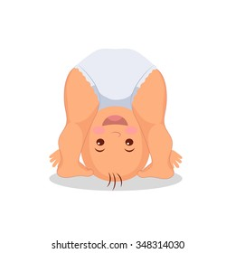 Funny playing baby standing on his head. Little cute baby playing upside down.  Isolated kid on the white background.
