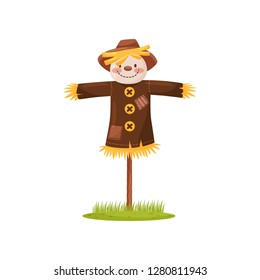 Funny scarecrow of straw with smiling face, dressed in brown shirt and hat. Human figure. Cartoon vector design
