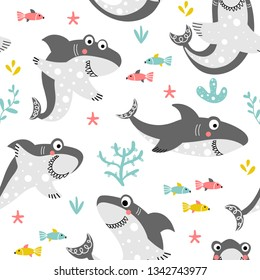 Funny seamless pattern with friendly smiling sharks and fishes on a white background with sea plants in a cartoon style. Illustration for children in vector.