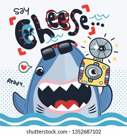 """Funny shark cartoon holding retro camera and text """"SAY CHEESE"""" on white background illustration vector."""
