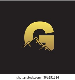 G alphabet mountain negative space letter logo gold black background