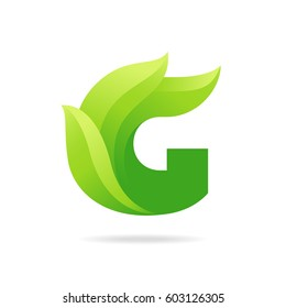 G icon with green leaves. Vector eco design.