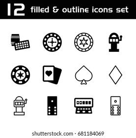 Gambling icon. set of 12 gambling filled and outline icons such as roulette, spades, slot machine, diamonds, domino, slot machine, lotto