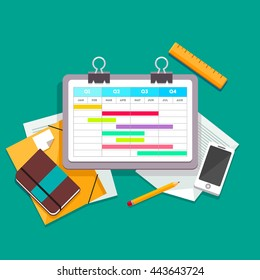 Gantt chart planning process document on a paperclip lying on the desk next to other documents, files, phone and personal notebook. Flat style vector illustration.