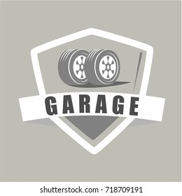 Garage and tyre badge