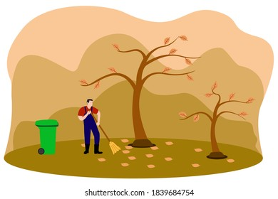 A gardener collects and cleans fallen leaves in the fall with a broom and garbage bin
