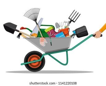Gardening tools set in wheelbarrow. Equipment for garden. Saw bucket ax wheelbarrow hose rake can shovel secateurs gloves boots. Vector illustration in flat style