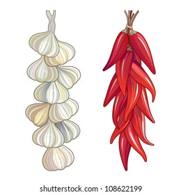 Garlic and red chili tied in a traditional string. Hot and spicy flavouring ingredients used in worldwide cuisine.