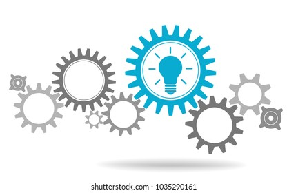 Gear wheels with symbolizing idea Blue light bulb background