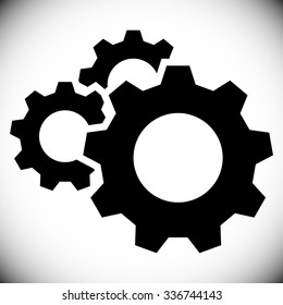 Gears, gear wheels, cog wheels on white