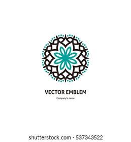 Gentle blue beautiful circular logo for boutique, flower shop, business, interior. Company mark, emblem, element. Simple geometric mandala logotype. Kaleidoscope big bud. Surround abstract blossom.