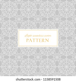 Geometric light grey ornate vector seamless pattern. Abstract texture with decorative hand drawn mandala elements. Elegant background for design and decor