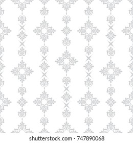 Geometric patterns formed from squares.Template for embroidery, decoration cards, wrappers, business cards, gift tags, labels, and textile elements of interior design.Vector seamless illustration.
