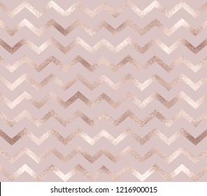 Geometric rose gold chevron seamless pattern.