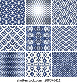 Geometric seamless ethnic background collection in blue and white